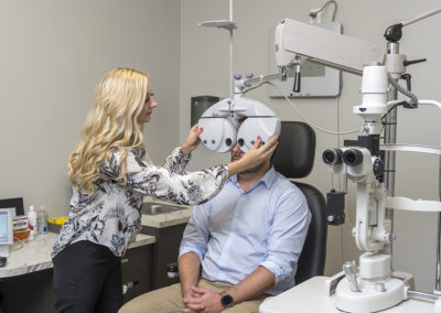 Dr Bever with patient eye exam